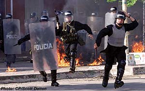 Colombian riot police moving against a protest of 3500 coca-farmers who oppose fumigation.