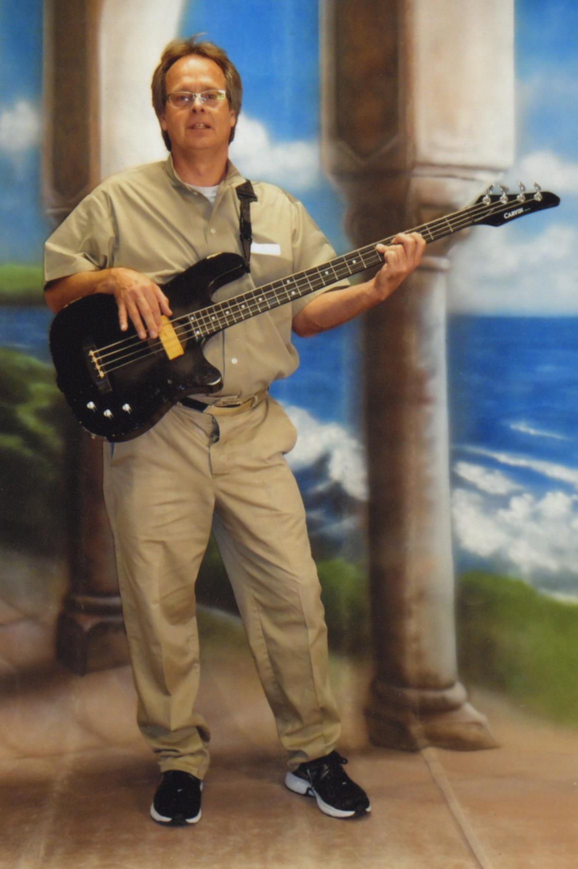 Marc Emery bass guitar