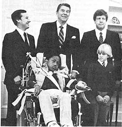 A young Jonathan Magbie (in wheelchair) meets with President Reagan in 1982.