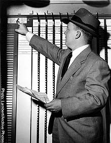 Man votes with a 1960`s era voting machine