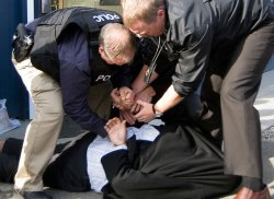 Carl Anderson, shown here being arrested during a Nov. 1 RCMP raid. (photo: KTW)