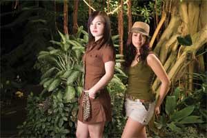 "Sally (left) wears:Brown ""Summer"" hemp dress by Hemp Hoodlamb ($85); vintage scarf (stylist's own)  Sonya (right) wears:  Olive bamboo/organic cotton ""Cresent Cami"" by Satori ($35); hemp ""Summer"" shorts by Hemp Hoodlamb ($65); green ""Be Fair"" hemp fedora"