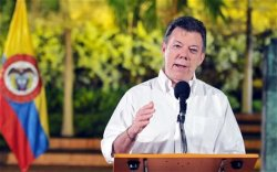 When asked if making marijuana legal could offer a way forward, President Juan Manuel Santos said it could and that he would support it.  (EPA/Felipe Ariza)