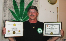 Ed deVries displays his ordination certificate as a minister of the Church of the Universe and the official charter for the Best Plant Believers Mission of Nunavut. The charter document was on the door of the room of his house where guests buy and consume marijuana and derivative products. DeVries argues that room was therefore marked as a church sanctuary which should not have been violated by police. - Gabriel Zarate/NNSL photo