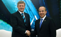 Mexican President Felipe Calderon and Canadian Prime Minister Stephen Harper shake hands during a summit of the Security and Prosperity Partnership of North America. (Photo by Alfredo Guerrero)