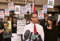 Marc and Jodie Emery speaking to supporters and journalists about Marc's expected 5-year prison term in the United States (Photo from CTV)