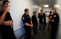 Police crowd into the office of Conservative MP Terence Young's Oakville office before arresting a 'Free Marc' protestor for trespassing. (Photos by Leah Gair)