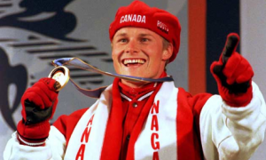 Men's Giant Slalom Snowboard gold medal winner Ross Rebagliati of Canada shows his delight during the medal ceremony at the XVIII Winter Olympic Games, February 8, 1998. (Photo by Dylan Martinez/Reuters)