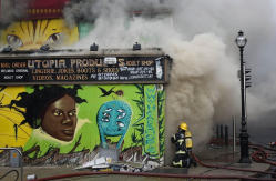 Members of the Dublin Fire Brigade tackle a blaze at the Nirvana head shop on Capel Street on Feb. 12, 2010. (Photo by Niall Carson)