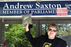 'Free Marc' organizer Jacob Hunter protesting outside Conservative MP Andrew Saxton's office in North Vancouver. (Photo by Jeremiah Vandermeer - click to enlarge)