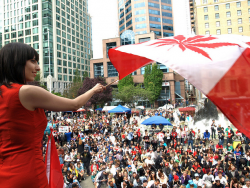 Activist Jodie Emery waves the Cannabis-Canada flag for thousands of stoney supporters at the Vancouver Art Gallery.