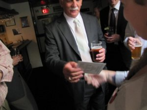 Caroline hands Vic Toews a FREE MARC info sheet