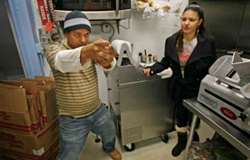 Sirilo Ortiz, former owner of Lycomings Grocery, re-enacts his ordeal with cops just five days after buying the Hunting Park shop. He says plainclothes officers entered his store aiming their guns at him. Maria Espinal also was in the store.