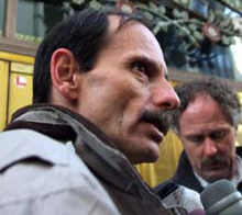 Grant Krieger, speaking to reporters outside a Calgary courthouse in 2000, signed a legal document Tuesday pledging to stop growing or distributing marijuana. (Adrian Wyld/Canadian Press)