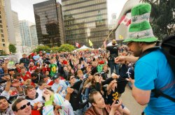 David Malmo-Levine throwing joints to the crowd at a Vancouver pot rally. (Photo by Bert Easterbrook)