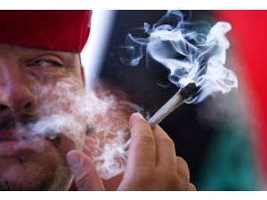Pony Boy from the group Los Marijuanos smokes marijuana in the smoking tent outside the Kush Expo in Anaheim in July.