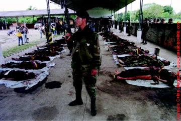 Colombian soldier shows off bodies of dead FARC rebels