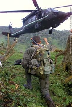 Colombian officer signals to a US-donated helicopter. BC`s future?