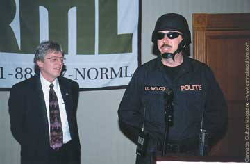 Keith Stroup and mock policeman: stoked about the conference.