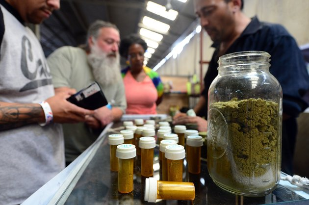 Card-carrying medical marijuana patients eager to learn more about Kief, in jar, at Los Angeles' first-ever cannabis farmer's market at the West Coast Collective medical marijuana dispensary, on the fourth of July, or Independence Day, in Los Angeles, California on July 4, 2014 where organizer's of the 3-day event plan to showcase high quality cannabis from growers and vendors throughout the state. Kief, which refers to the resin glands of cannabis that accumulates from sifting the loose dry cannabis flower with a sieve or mesh screen, has traditionally been pressed into cakes and called hashish.  AFP PHOTO/Frederic J. BROWN        (Photo credit should read FREDERIC J. BROWN/AFP/Getty Images)