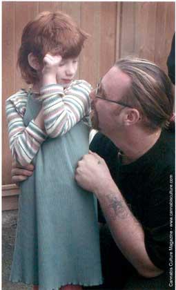 Jason Rowsom comforts his daughter after police invasion.