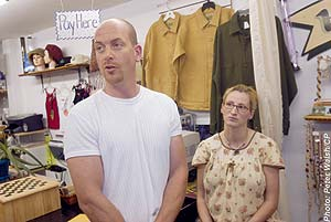 Jim and Lynn Wood at their store before the raid.