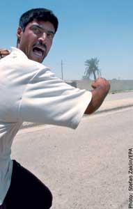 A man runs from Abu Ghraib prison.