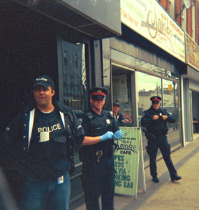 Police outside the cafe while cops search inside