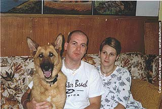 Jim and Lynn Wood, pet Cheyenne: police kicked in door and shot dog without IDing themselves.