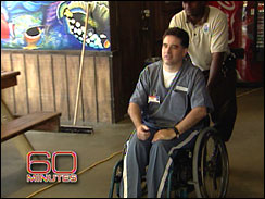 Richard Paey in his prison uniform and wheelchair