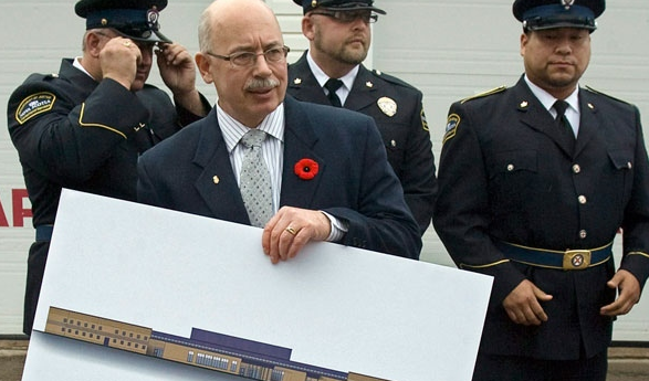 Nova Scotia Justice Minister Ross Landry, accompanied by senior corrections officers, holds a drawing of a new 100-cell jail after a news conference in Thorburn, N.S. on Monday, Nov. 1, 2010. Photo by Andrew Vaughan