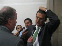 Mexico City Mayor Marcelo Ebrard ponders a question from a reporter at City Hall on Tuesday. (photo: Daniel Hernandez, LA Times)