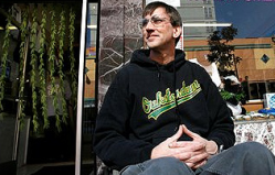 Richard Lee, president of Oaksterdam University, sits in front of the school's gift shop in Oakland. (AP Photo/Dino Vournas)