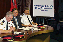 Toronto Police Supt. Ron Taverner (left), Tory MPP Garfield Dunlop and Orangeville Police Chief Joe Tomei (right) announce their support for Tory MPP Garfield Dunlop's private members bill that would consider kids growing up in marijuana grow-ops victims of child abuse. (ANTONELLA ARTUSO/Toronto Sun)