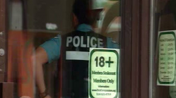 A police officer can be seen inside the compassion club on St. Laurent boulevard in Montreal. (CBC Photo)