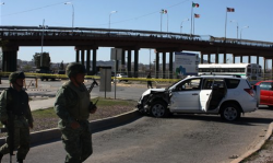 A U.S. consulate employee and her husband were shot to death Saturday in their car near the Santa Fe International bridge linking Ciudad Juarez with El Paso, Texas. (AP Photo)