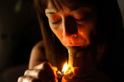 "During a very bad morning of steady pain and nausea Deana Martinez uses a small pipe hoping for quick relief after hours of struggle. The lack of sleep, pain and frustration brings her world crashing down around her. ""If it hadn't been for the medical marijuana I would not have made it through the last year."" she said. (Joe Amon)"
