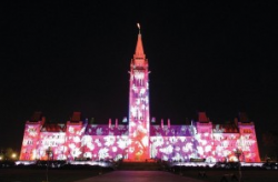 Canada's Parliament building lit up with psychedelic colors during an annual light show.