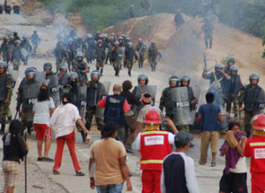 On June 5, the Peruvian National Police massacred up to fifty unarmed Awajún and Wampi indigenous people in Bagua who had blockaded roads in protest of land reforms. (Photo: Thomas Quirynen)