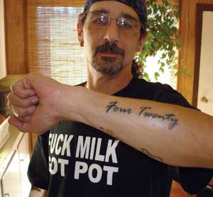 "Mik Mann (Opus on the CC forums) is a legal medical marijuana user and grower, and one of the most hard-core marijuana activists in Canada. He got a ""Four Twenty"" tattoo on his left arm, the ""No Extradition"" logo on his right arm, and added the ""Cannabis"