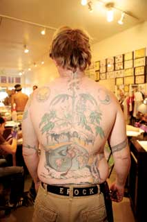 Shawn's brother came to Sacred Rose to show me the massive cannabis themed tattoo on his back
