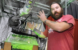 McClure, of the Medical Marijuana Caregivers of Maine, talks about indoor growing equipment in the Maine Hydroponics Supply booth during the Home Grown Maine trade show Saturday at the Augusta Civic Center. (Photo by Joe Phelan)