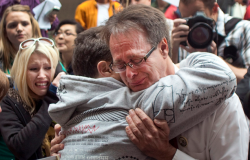 Canadian marijuana activist Marc Emery cries while embracing a friend before being extradited to the U.S. on charges of distributing marijuana seeds.