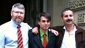 Matthew Mernagh (centre) exits Ontario's Court of Appeal after conclusion of hearings, May 8, 2012. Left: Freedom Party of Ontario Leader Paul McKeever. Right: Mernagh's Lawyer Paul Lewin.
