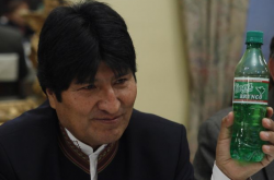 "Bolivian President Evo Morales holds a bottle of ""Coca Brynco"", a new soft drink made from the coca leaf."