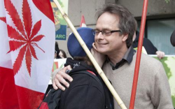Marc Emery saying farewell to his friends before being hauled away to an American prison.