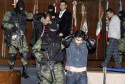 Suspected Mexican drug trafficker Vicente Zambada Niebla, in black blazer, is presented to the media in Mexico City. Mr. Zambada is the son of the co-head of the Sinaloa cartel. (photo: Reuters)