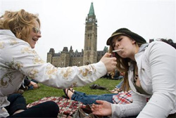 Protesters light a marijuana joint at a demonstration in support of marijuana legalization on Parliament Hill on Apr. 20, 2009.