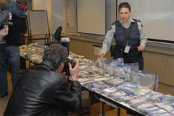 Cpl. Marlene Morton shows off contraband allegedly seized from the storage locker of The Compassion Association.