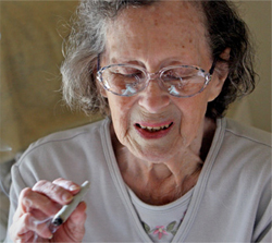 RELIEF: Betty Hiatt, 81, smokes medicinal marijuana at her Seattle home. Having survived cancer, Crohn's disease and the onset of Parkinson's disease, the grandmother said a few puffs each morning help quell the nausea caused by her multiple prescription drugs.